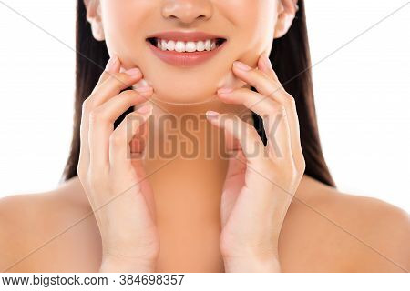 Partial Shot Of Excited Young Woman Touching Face Isolated On White