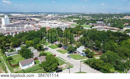 Aerial View Green Neighborhood With Family Houses Next To Rental Buildings Outside Downtown Carrollt