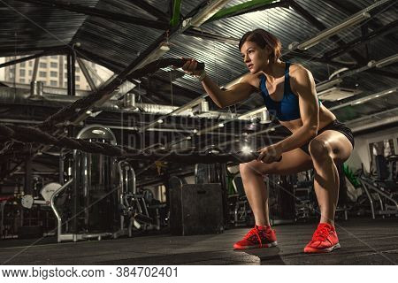 Get Stronger! Female Athlete Working Out With Heavy Ropes At The Gym Copyspace Cross Fit Functional