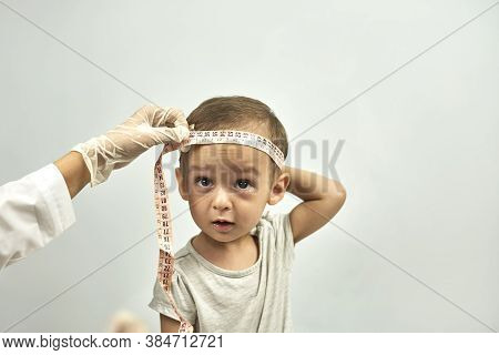Doctor Measuring Baby Head Circumference. Pediatrician Place Measuring Tape Around Your Baby Head An