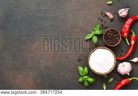 Set Of Spices, Garlic, Fresh Basil And Chili On A Concrete Background. View From Above.