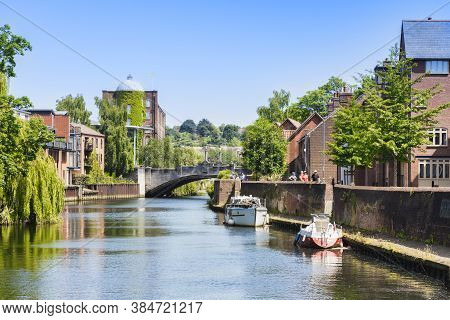 29 June 2019: Norwich, Norfolk, Uk - Tourists Walking Beside The River Wensum On A Sunny Summer Day.