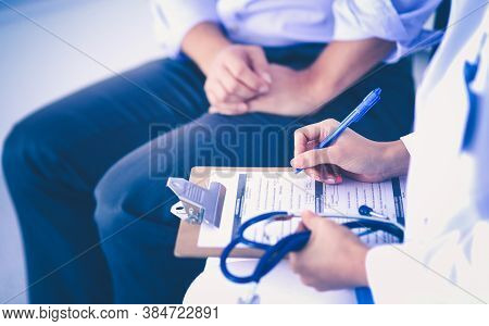 Doctor Woman Sitting With Male Patient At The Desk