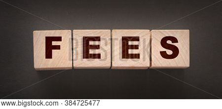 Wooden Blocks With The Word Fees . Taxes And Fees Business Concept