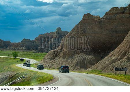 South Dakota, Usa - June 21, 2020: Cars Travel The Badlands Loop Roadl In Badlands National Park, As