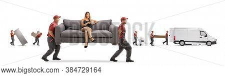 Movers carrying a couch with a young woman sitting and drinking coffee while other movers loading a van isolated on white background