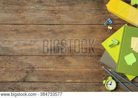 Set Of Colorful Stationery On Wooden Table, Flat Lay With Space For Text. Teacher's Day
