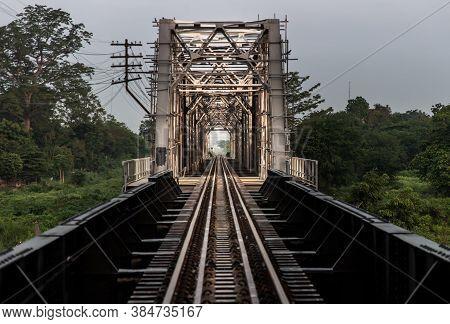 Old Railroad Tracks On Black Bridge Or Lampang Railway Bridge. Railway Bridge On River At Lampang Th