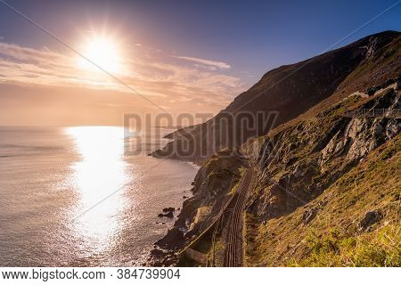 Dramatic Sunrise With Sun Star On A Cliff Walk Between Bray And Greystones With Beautiful Coastline,