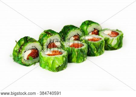 Sushi Roll Green With Chuka Salad On A White Plate, Classic Japanese Sushi. Traditional Japanese Foo