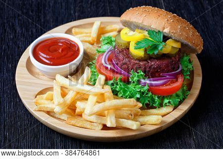 Vegan Beet Burger With Pickles Fresh Lettuce, Tomatoes, Red Onions, French Fry, Ketchup On A Bamboo