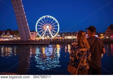 Gdansk, North Poland - August 13, 2020: A Couple Male And Female Looking At The Cityscape Over Motla