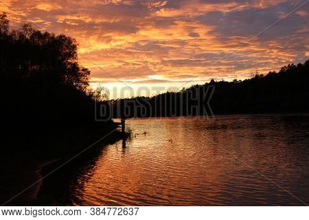 Sunny Rays Leaving With Decline. Evening Landscape. Beautiful Summer Decline Above Lake. Beautiful B
