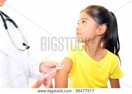 Doctor injecting child vaccine