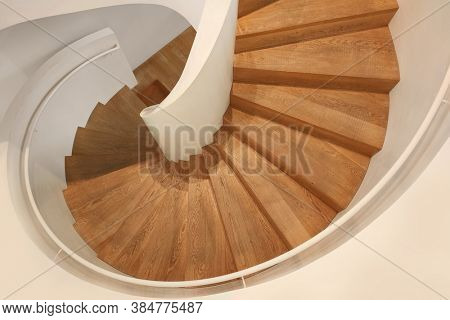 An image of a wooden spiral staircase