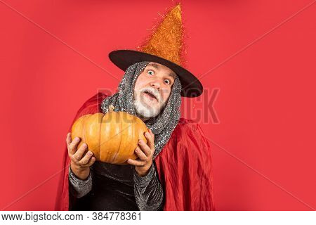 Halloween Man With Pumpkin. Halloween Party. Witch Man In Hat And Cloak. Happy Halloween. Weird Old