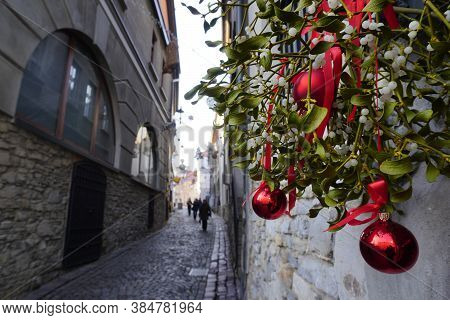 Christmas Mistletoe-bough Decorated For The Holiday In England. Kissing Bough With Red Balls, Evergr