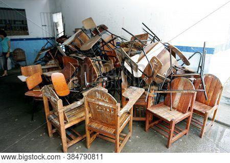 Eunapolis, Bahia / Brazil - March 23, 2011: Furniture In Broken Classroom Is Seen At Humberto De Cam