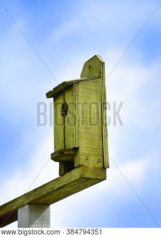 Green Wooden Birdhouse With Single Opening