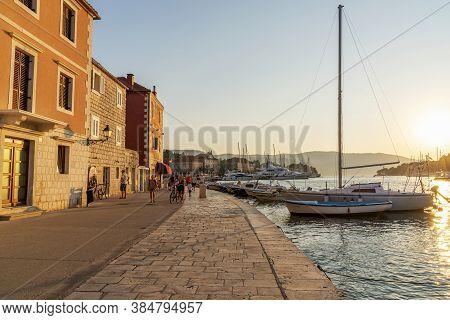 Stari Grad Croatia - 12 August 2020: Embankment Of Stari Grad Town On The Hvar Island With Walking P