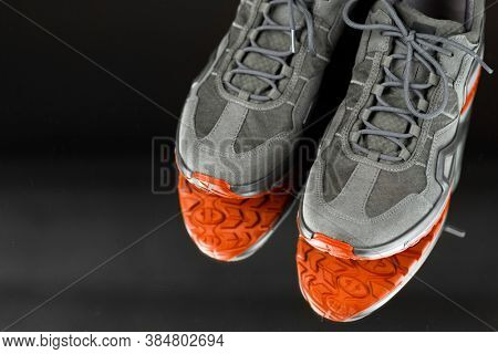 trekking sneakers with red sole, close-up view