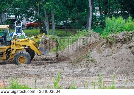 Landscaping Works On The Bulldozer Moves Soil Digging Ground Construction Earthmoving