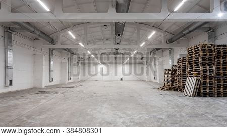 Industrial Building Interior With White Brick Walls, Concrete Floor And Empty Space For Product Disp