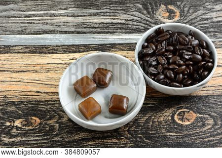 Coffee Candies And Coffee Beans In Candy Dishes On Table