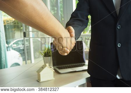 Both Businessmen Handshake. They Agree With The Contract. Contract Signing And Contract For Sale And