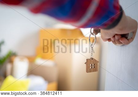 The New Home Owner Opens The Door Of The Room. Inside The Room There Are Personal Belongings That Ar