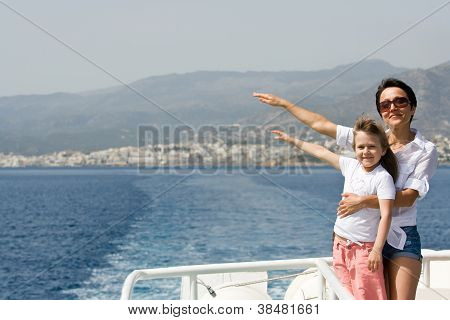 Mother, Little Daughter Enjoy Wind And Sea Travel On Boat