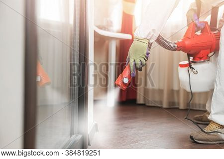 Pest Control Specialist In Hazmat Contractor Working Floor And Skirting Processing
