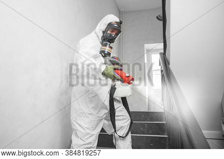 Concept Coronavirus Disinfection. People In Hazmats Making Cleaning In Stairwell Of Apartment Buildi