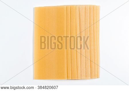 Top View Of Lasagna Sheets Stack Isolated On White. Pile Of Dried Lasagna Pasta Sheets
