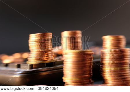 Stacks Of Gold Money Coin On Black Background And Concept Saving Money