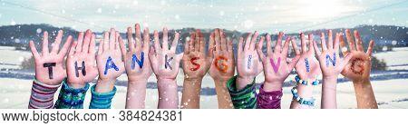 Children Hands Building Word Thanksgiving, Snowy Winter Background