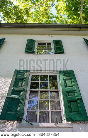 Historic Colonial American Home With Beautiful Woodwork And Antique Windows. Wooden Dowel Constructi
