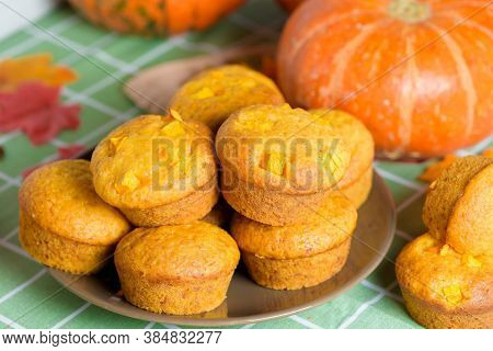 Autumn Pumpkin Cupcakes With Fresh Pumpkin For Thanksgiving Day. Autumn Composition Of Pumpkin And M