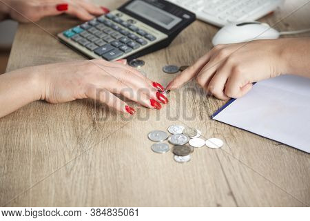 Young Girl Sorting,grouping Her Coins On Table With Laptop Beside.young Girl Counting Her Money On H