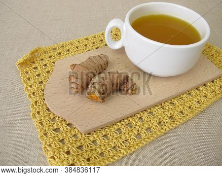 Cup Of Golden Yellow Tea With Turmeric