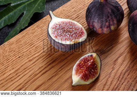 Fresh Ripe Figs On A Dark Concrete Background. Harvesting Figs