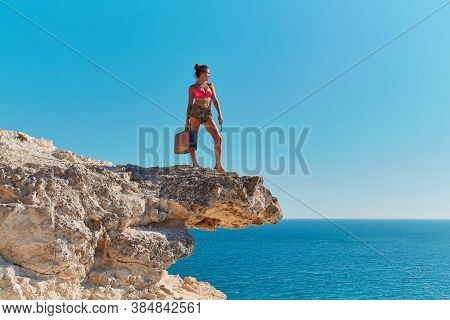 Woman In Beachwear With Suitcase And Glasses. Time For Travel. Summer Holiday. Travel Desire. Ocean