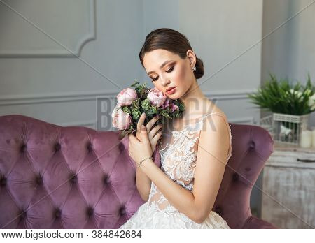 Beautiful Woman Posing In White Wedding Dress. Wedding Portait Of Happy Bride. Cute Bride With Weddi