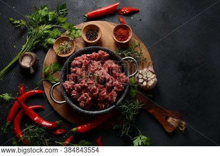 Minced Beef. Ground Meat With Ingredients For Cooking On Black Background