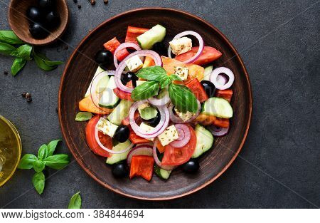 Classic Greek Salad With Feta On A Wooden Background.