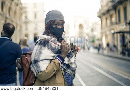portrait of a woman with mask in the city