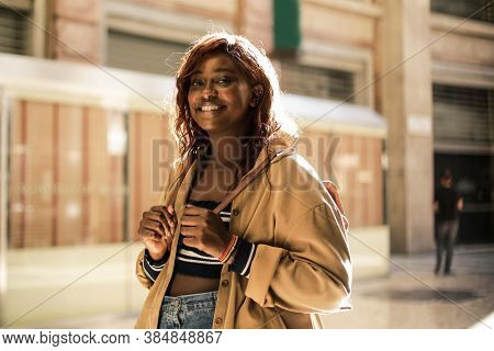 portrait of a smiling woman in the street