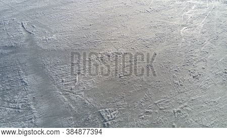 Ice Streaked With The Tip Of Figure Skates. Figure Skating On Ice. The Surface Of The Ice Rink After