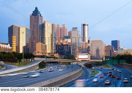 Cityscape Of Downtown Atlanta At Sunset With Traffic In The Freeway, Georgia, United States