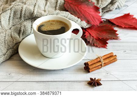Autumn, Fall Leaves, Hot Steaming Cup Of Coffee And A Warm Scarf On Wooden Table Background. Seasona